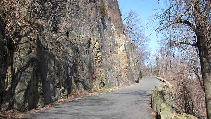 Photo of roadway and rock wall in Pallisades State Park, NJ.